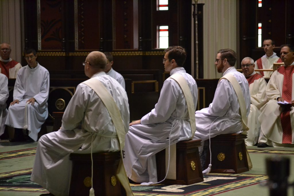 David Doseck, Peter Langenkamp, and Alexander Witt listen to Archbishop Schnurr's Homily (CT Photo/Greg Hartman)