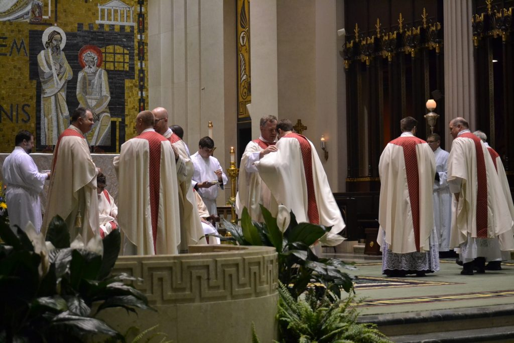 The newly ordained David Doseck, Peter Langenkamp, and Alexander Witt are vested with Eucharistic garments of their office, the stole and chasuble. (CT Photo/Greg Hartman)