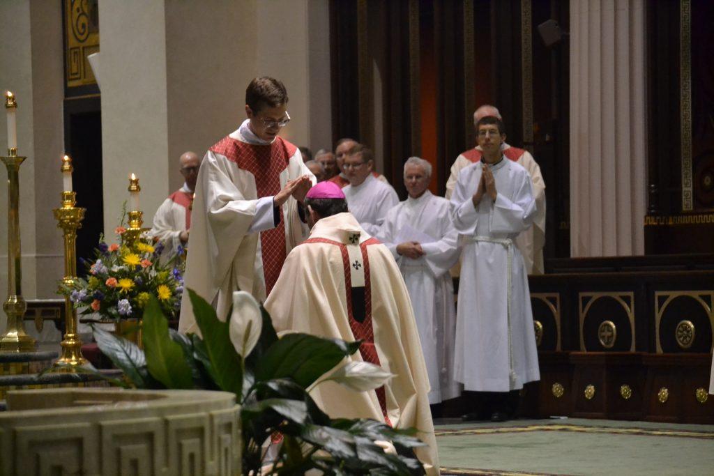 Reverend Langenkamp prays for Archbishop Dennis Schnurr (CT Photo/Greg Hartman)