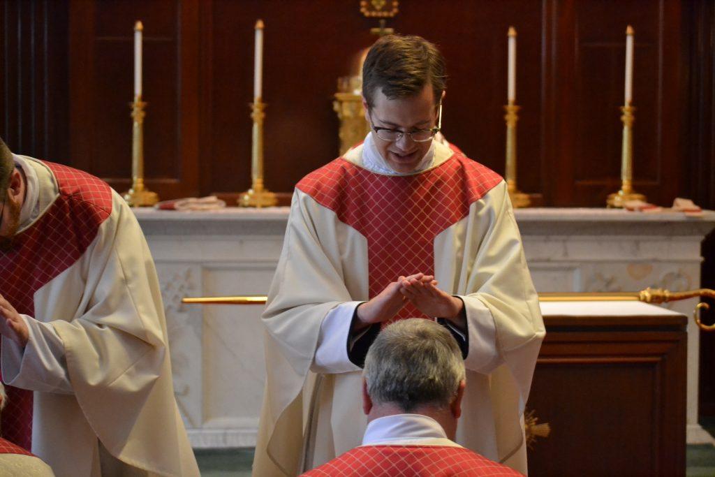 Reverend Peter Langenkamp laying of hands after Mass. (CT Photo/Greg Hartman)