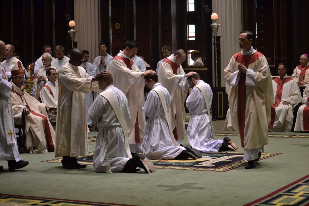 The concelebrating priests in Laying on of Hands. (CT Photo/Greg Hartman)