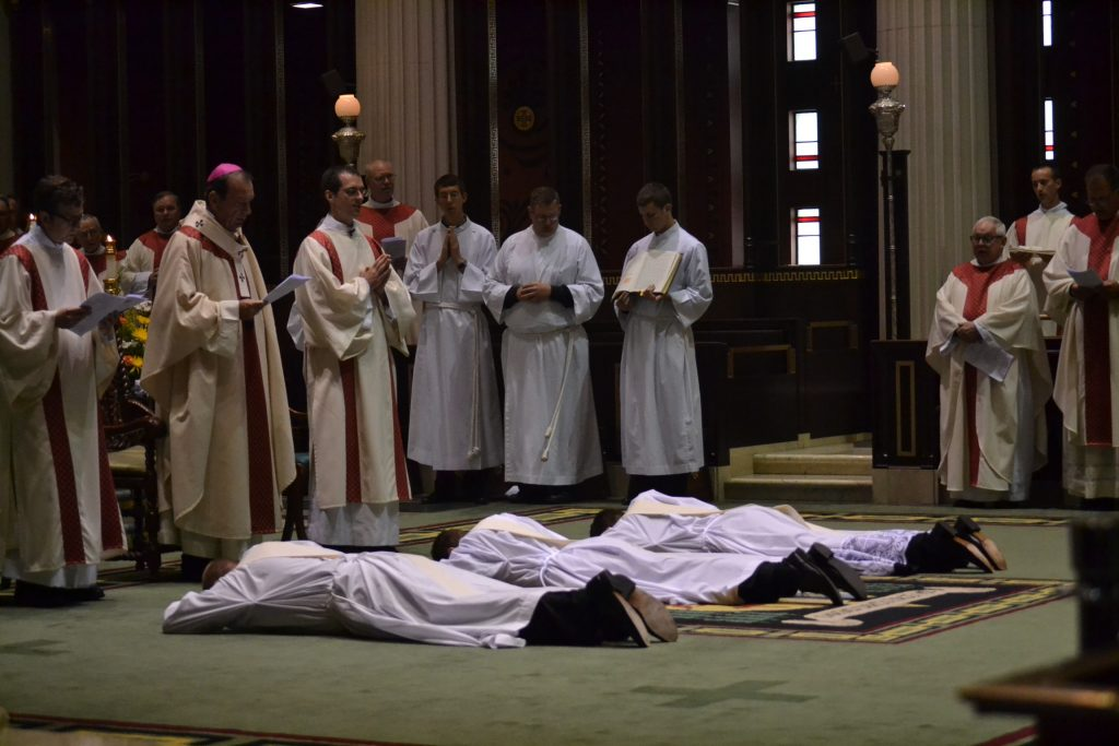 The candidates prostrate themselves while all sing the ancient prayer of the Church asking the saints to pray for God's blessing upon these candidates. (CT Photo/Greg Hartman