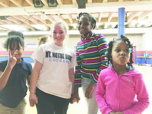 Kate Sampson poses with neighborhood children during a roller skating party in Over-the-Rhine.  (Courtesy Photo)