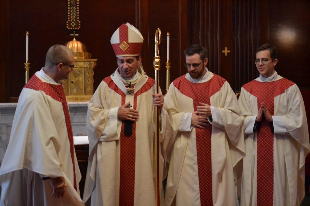 Reverend David Doseck, Archbishop Dennis Schnurr, Reverend Peter Langenkamp, and Reverend Alexander Witt (CT Photo/Greg Hartman)