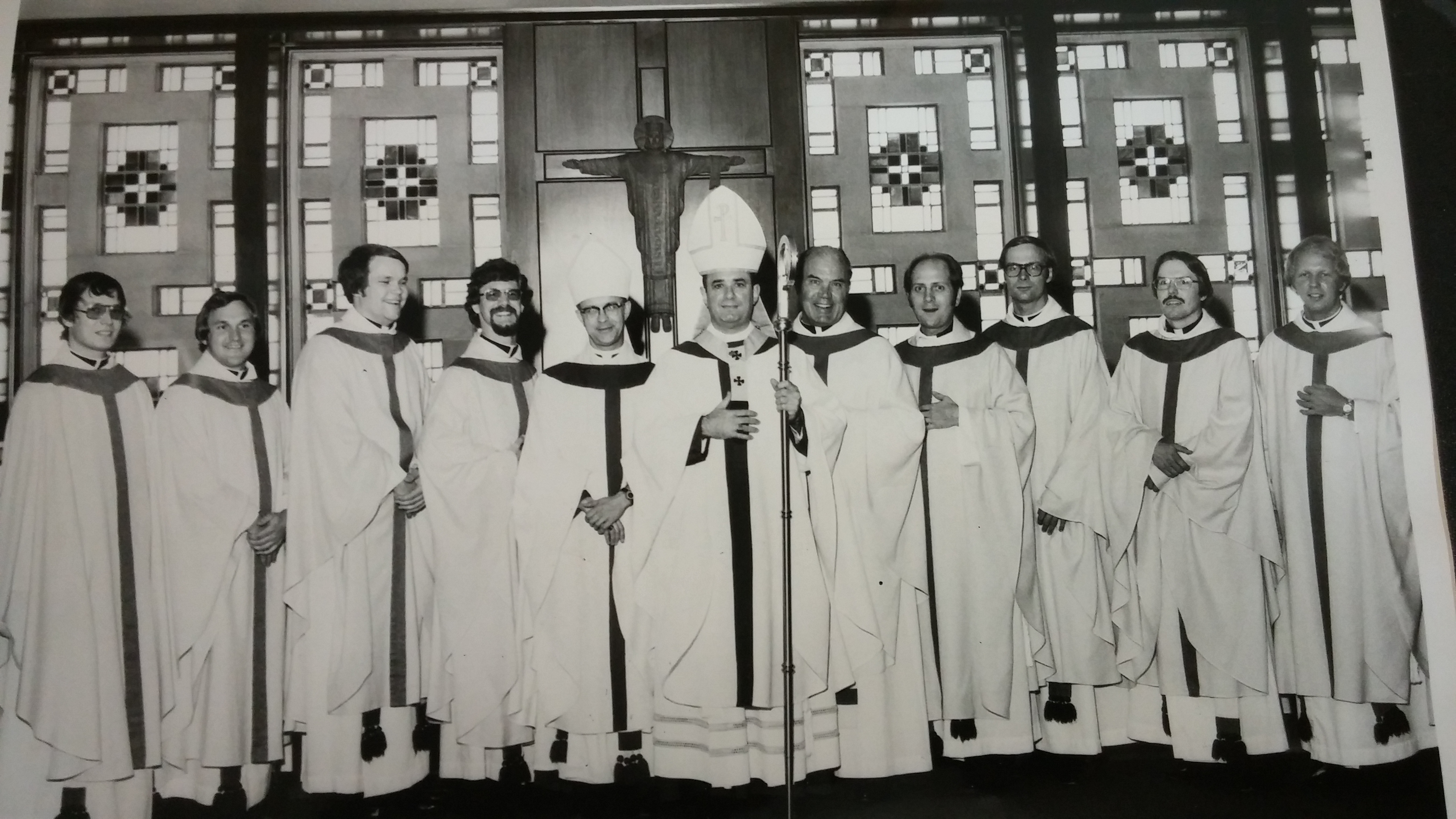 1976 Ordination (from l to r) Fathers Hans Gruenbauer, George Cooley, John Krumm, Carl Bach, Bishop Pilarczyk, Archbishop Bernardin, Father Favret, Fathers David Garrick, Thomas Feldhaus, Thomas Grilliot, Thomas Snodgrass