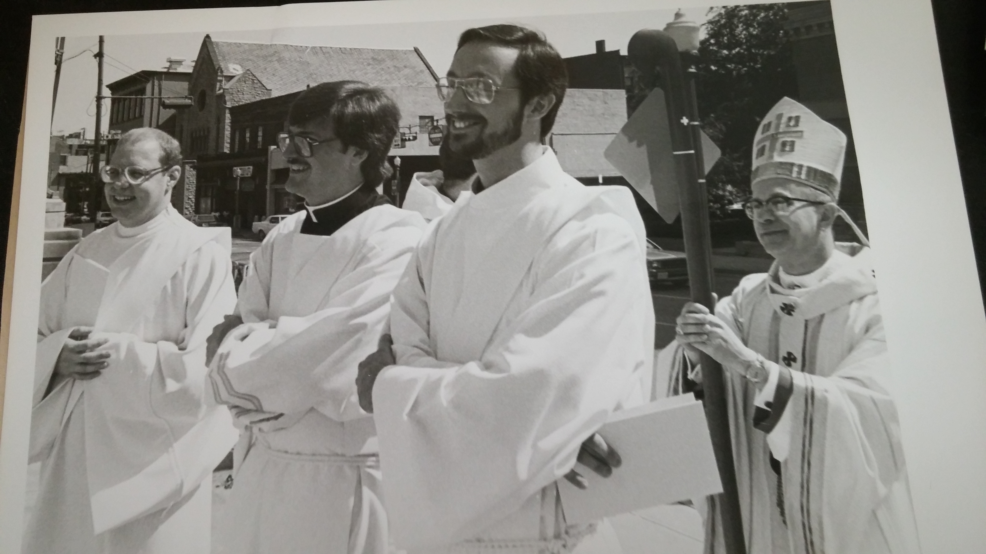 Deacons Jeffrey Silver, Steven Shoup, and Anthony Dattilo preparing for procession Ordination Day 1984