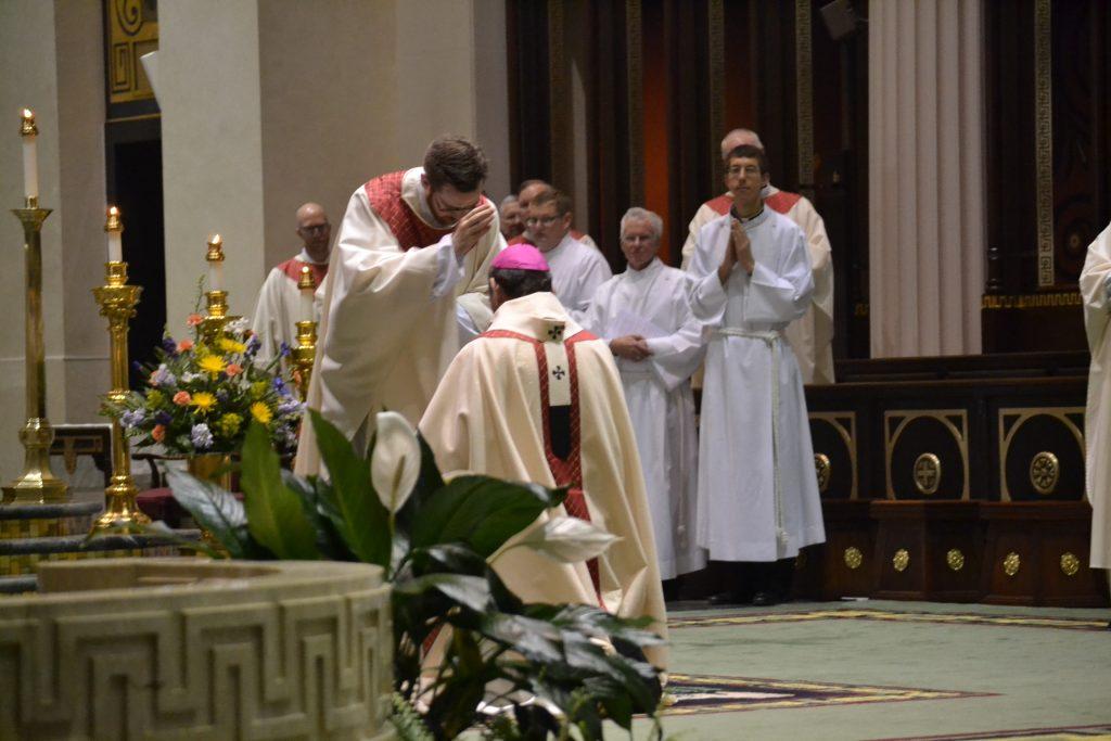 Reverend Witt prays for Archbishop Dennis Schnurr (CT Photo/Greg Hartman)