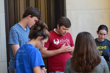 Groups began their night in prayer before takin it to the streets. (CT Photo/Greg Hartman)
