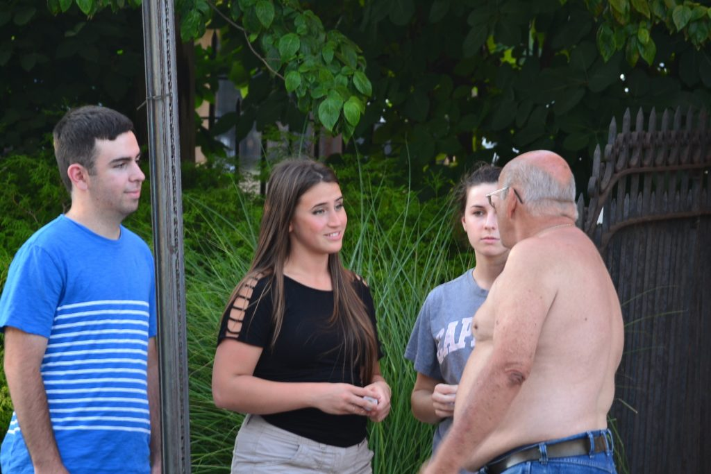 A group meets up with a Covington Resident on Light the City (CT Photo/Greg Hartman)