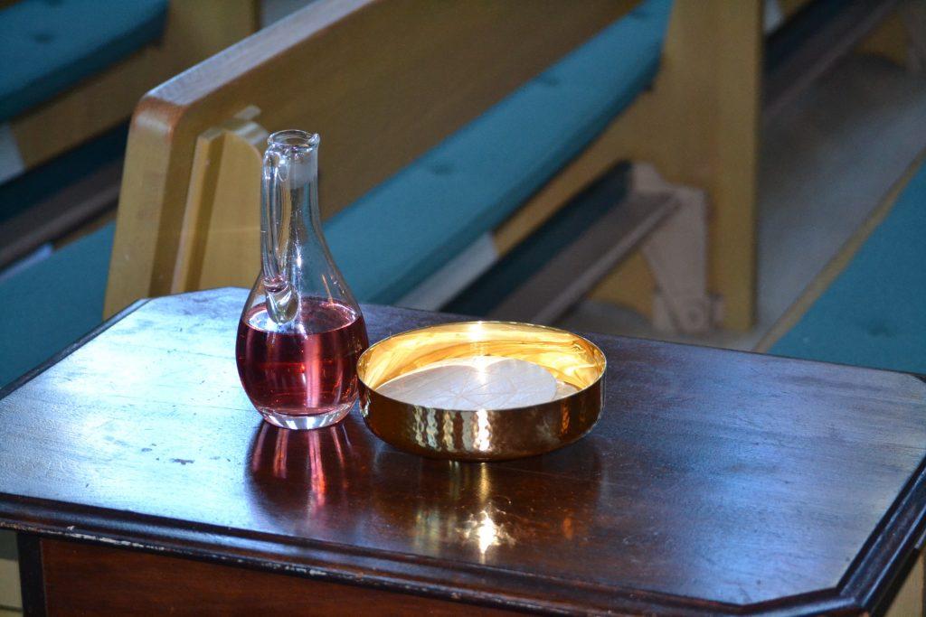 A quiet moment before Mass (CT Photo/Greg Hartman)