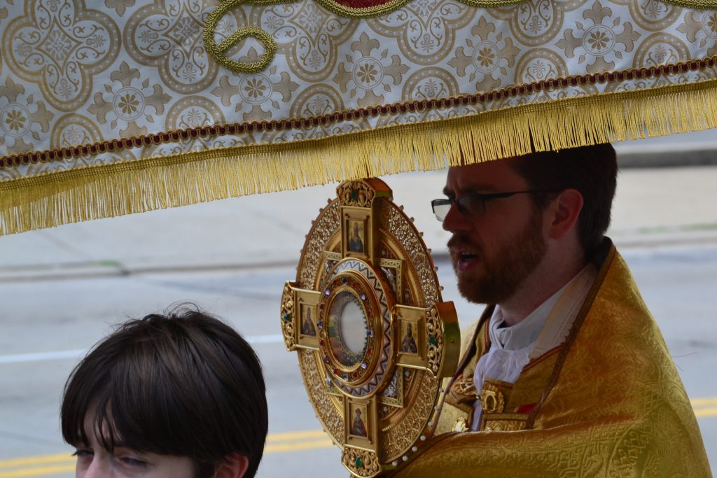 Fr. Alexander Witt carries the Monstrance during the procession. (CT Photo/Greg Hartman)