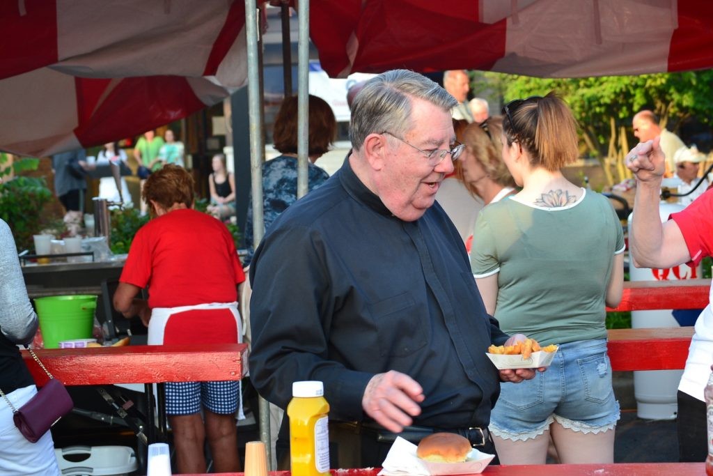 Fr. King enjoying a night at the festival (CT Photo/Greg Hartman)