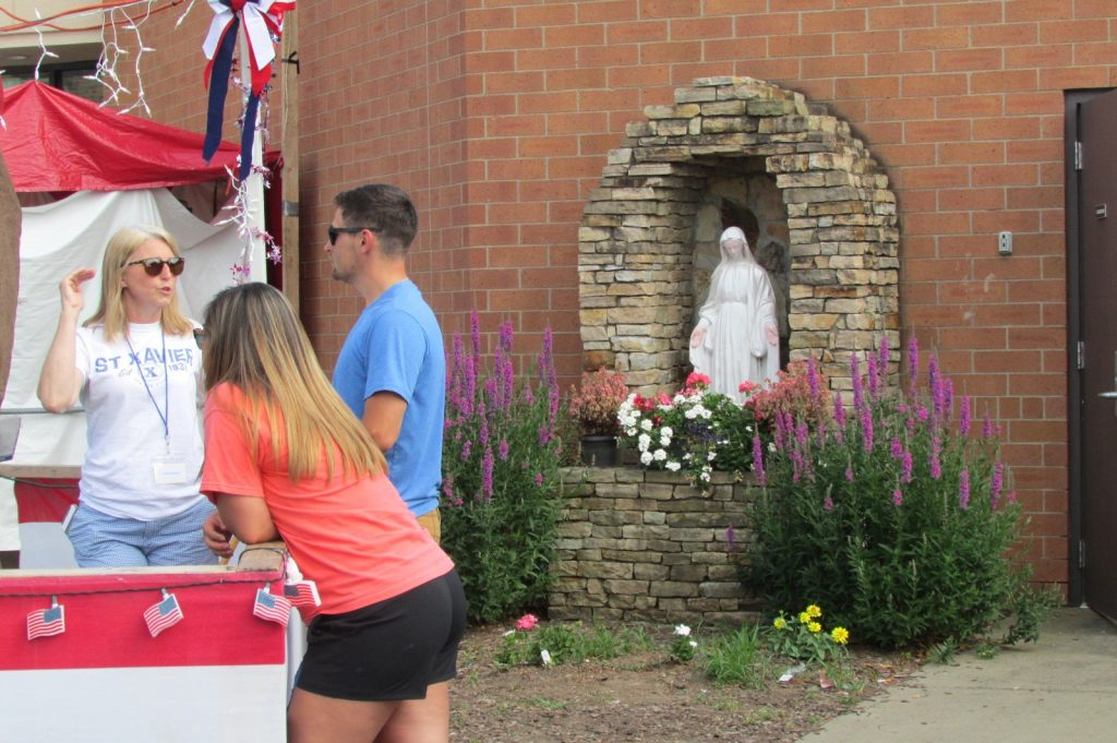 Visitors enjoying a day at the festival and a Mary Garden! (CT Photo/Greg Hartman)