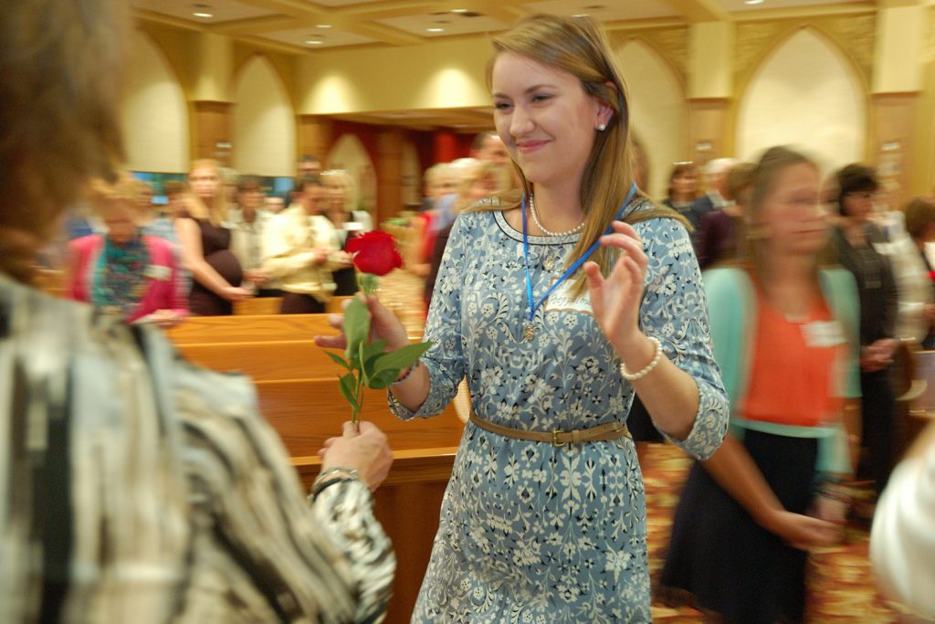 Colleen Poeppelman received her medal and rose. She is from St. Michael's, Ft. Loramie, Ohio (CT Photo/Jeff Unroe)