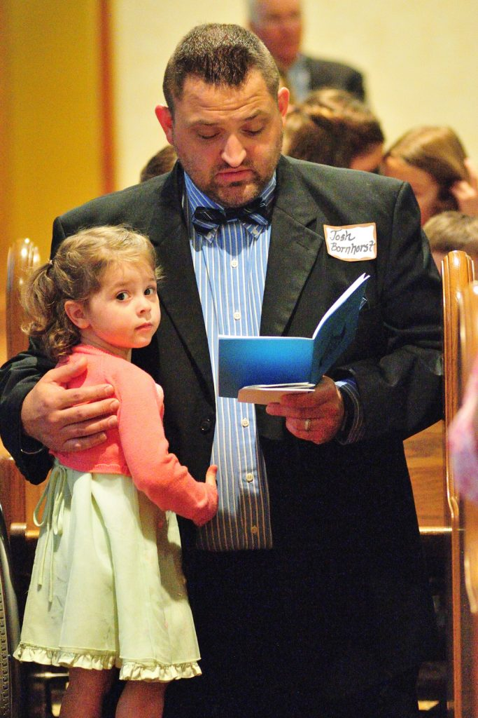 Josh Bornhorst and his 3 year old daughter Esther together during holy Mass (CT Photo/Jeff Unroe)