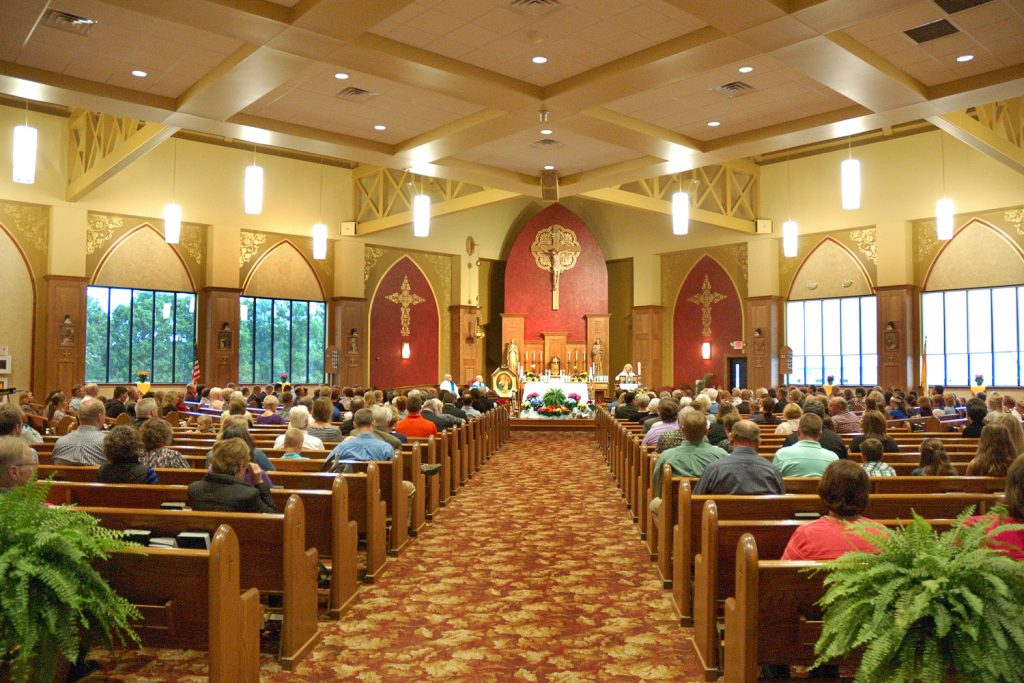 Schoenstatt Leader, Susan Bernhold addresses the congregation prior to holy mass. (Jeff Unroe/CT Photo)