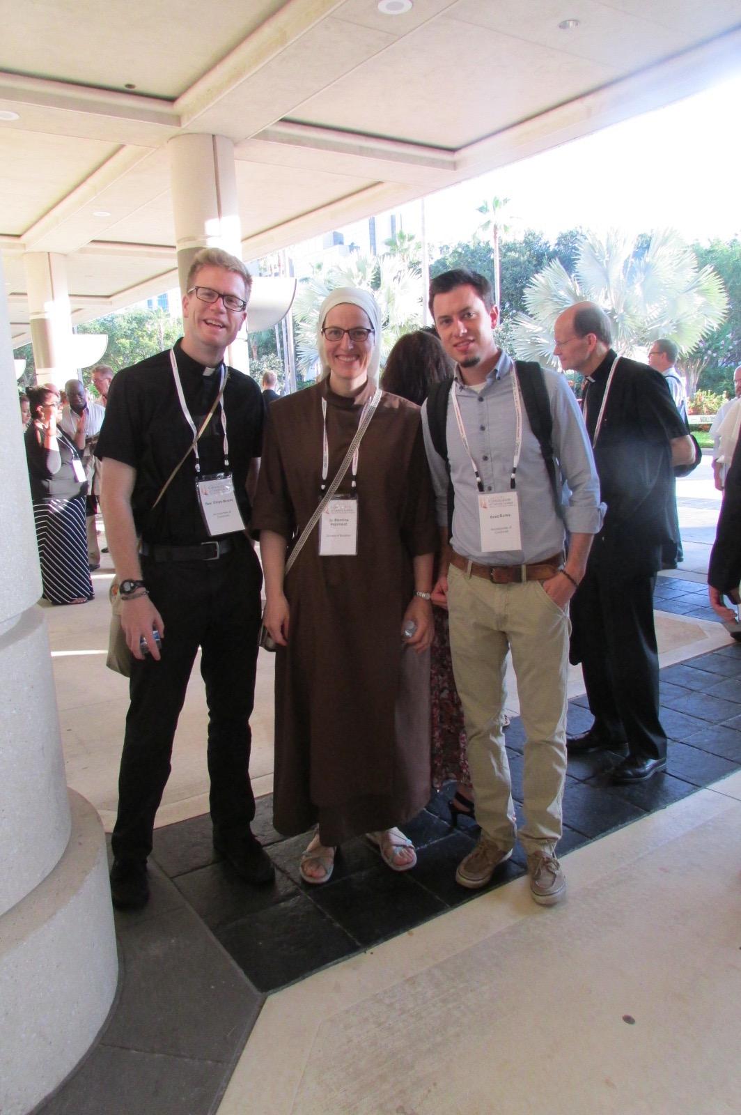 Father Ethan Moore and VIA Catholic head Brad Bursa with a new friend (CT Photo/Greg Hartman)