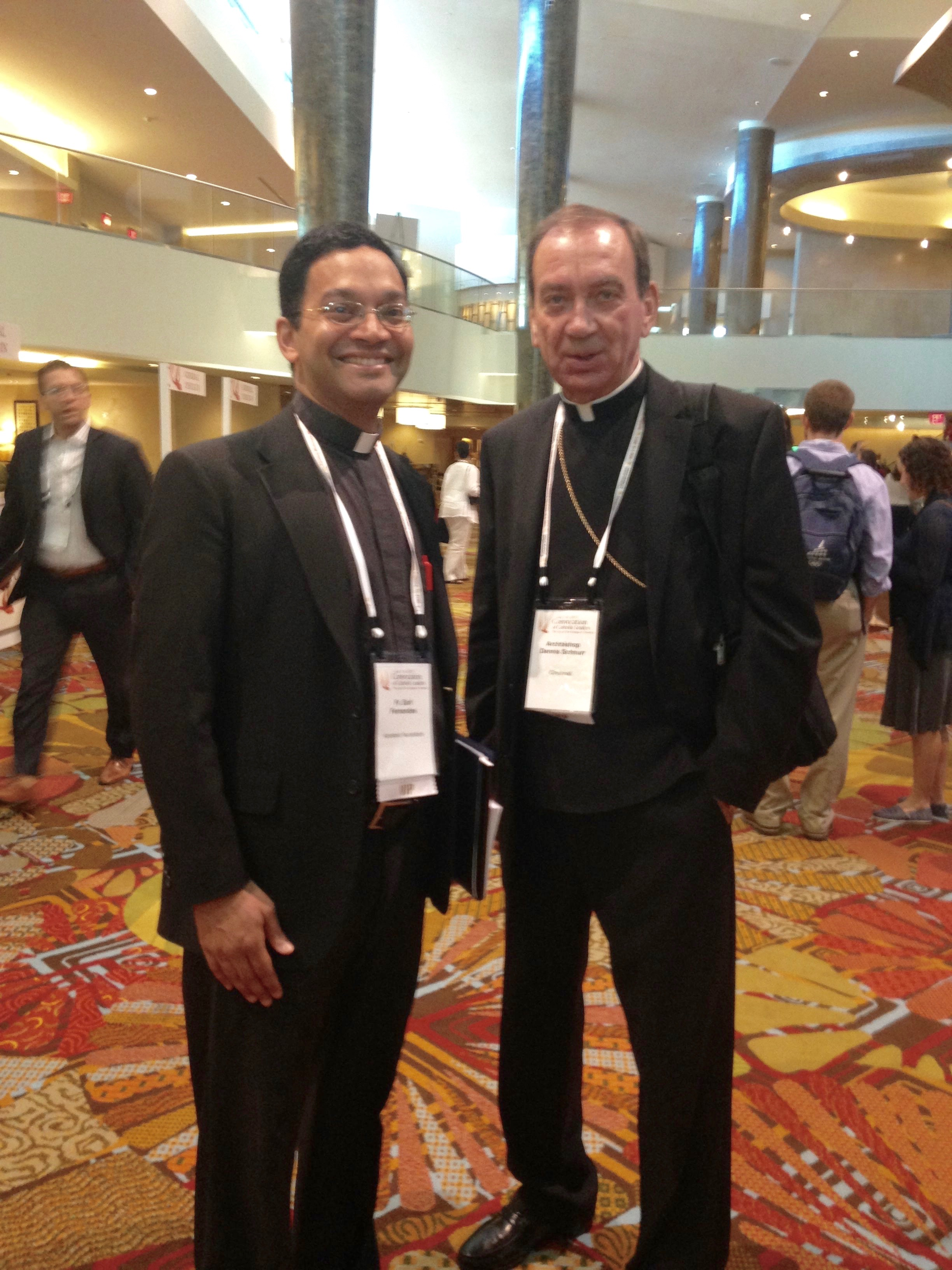 Father Earl Fernandes, former head of Mount St. Mary's Seminary of the West and now a secretary for the papal nuncio, Archibishop Christophe Pierre, with Archbishop Dennis M. Schnurr (CT Photo/Gail Finke)