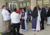 Local Children of Mary Sisters meet others waiting for the Eucharistic procession to begin (CT Photo/Gail Finke)