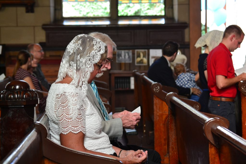 Parishioners in silent prayer before the 17th Anniversary Mass (CT Photo/Greg Hartman)