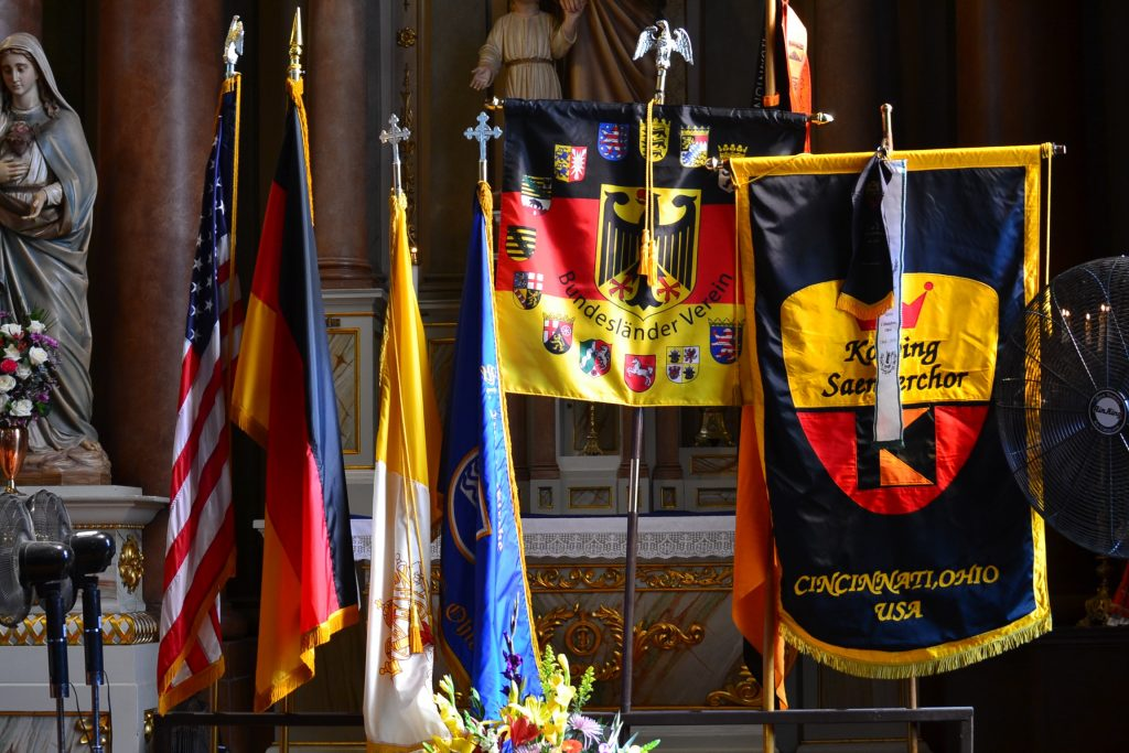 The American Flag, Vatican Flag and German Society Flags for the 175th Anniversary Mass. (CT Photo/Greg Hartman)