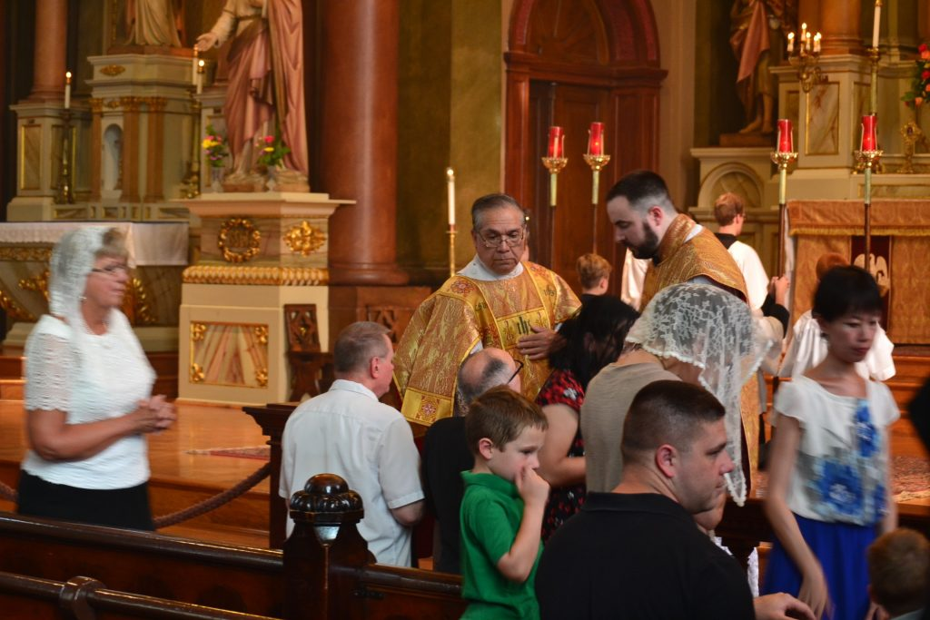 Distribution of Communion as it has for 175 years at Old St. Mary's. (CT Photo/Greg Hartman)