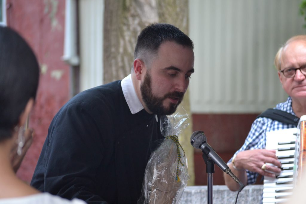 Fr. Jon-Paul Bevak accepting the statue of The Blessed Mother from Munich's St. Peter Parish. (CT Photo/Greg Hartman)