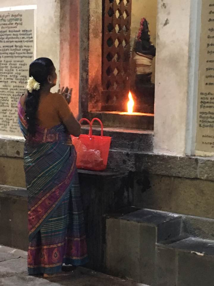 On the first day, they visited St. Thomas National Basilica and a Hindu temple, where the group got a photo of a woman in prayer. (Courtesy Photo)