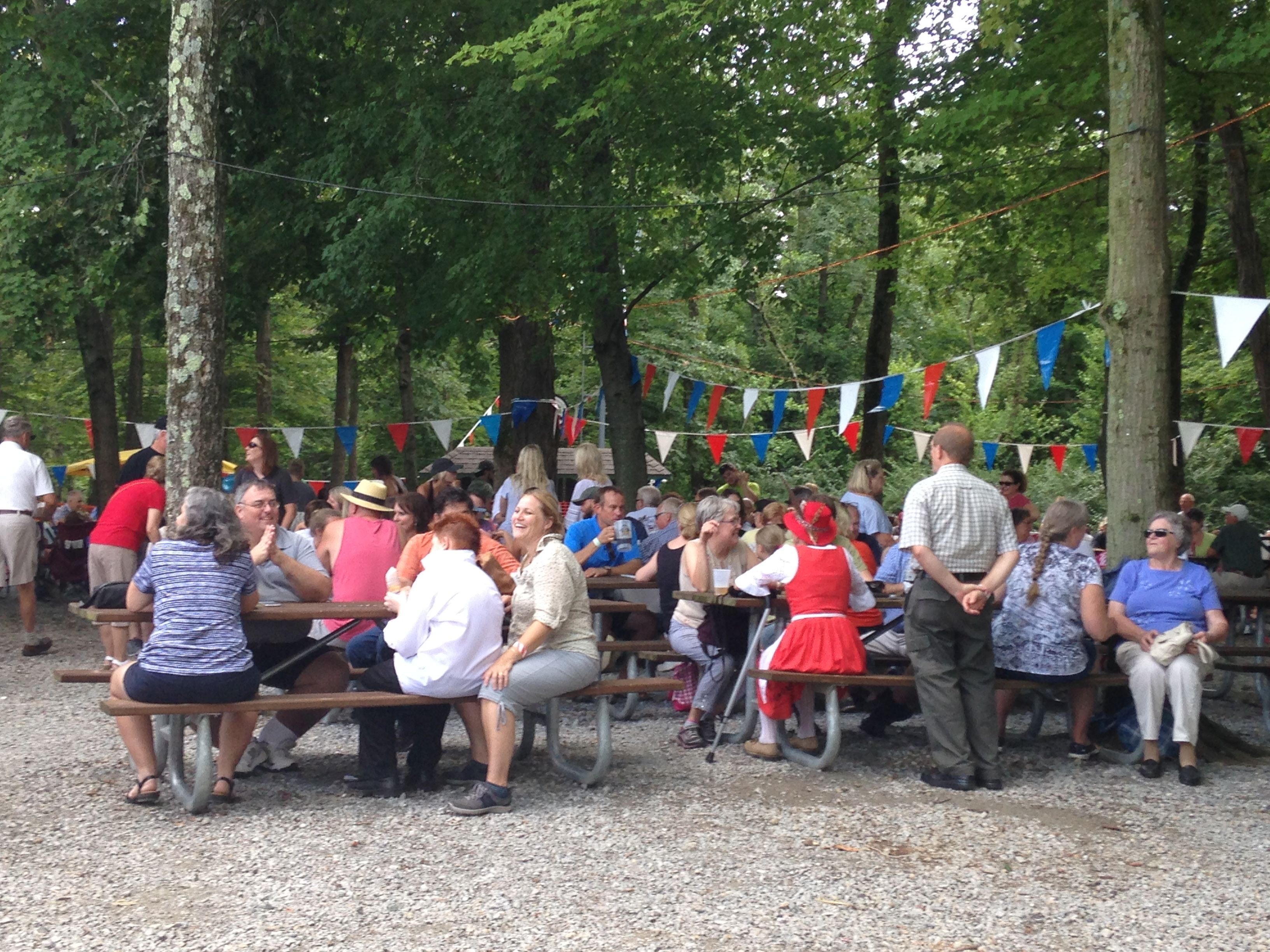 Diners enjoy a variety of German foods at the shaded picnic grove. (CT Photo/Gail Finke)