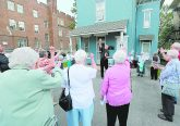 "Rev. Michael Pucke. pastor of St. Julie Billiart Catholic Parish in Hamilton, leads a cheer to Sr. Dorothy during the blessing of ""The Sr. Dorothy Stang House"", a house for homeless families, during a dedication ceremony in Hamilton Saturday, May 27, 2017. (CT Photo/E.L. Hubbard)"