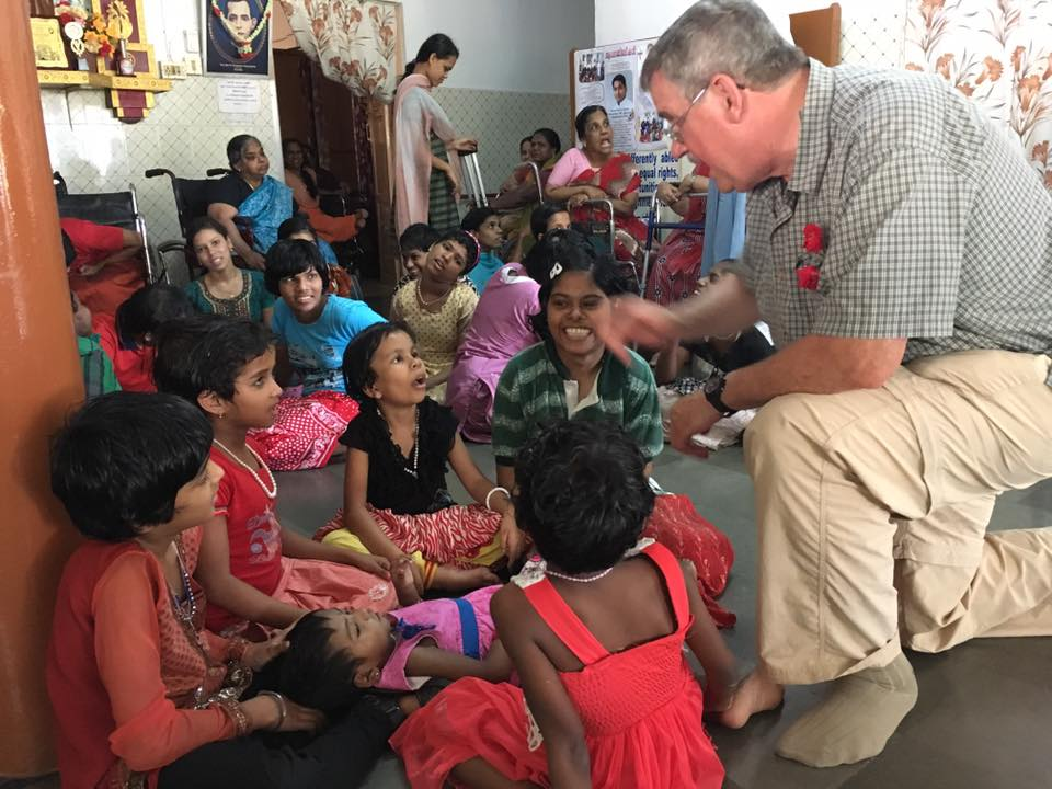 Visiting the Mercy Home for disabled girls. Mike Gable talks with young women. (CT Photo/Sister Eileen)