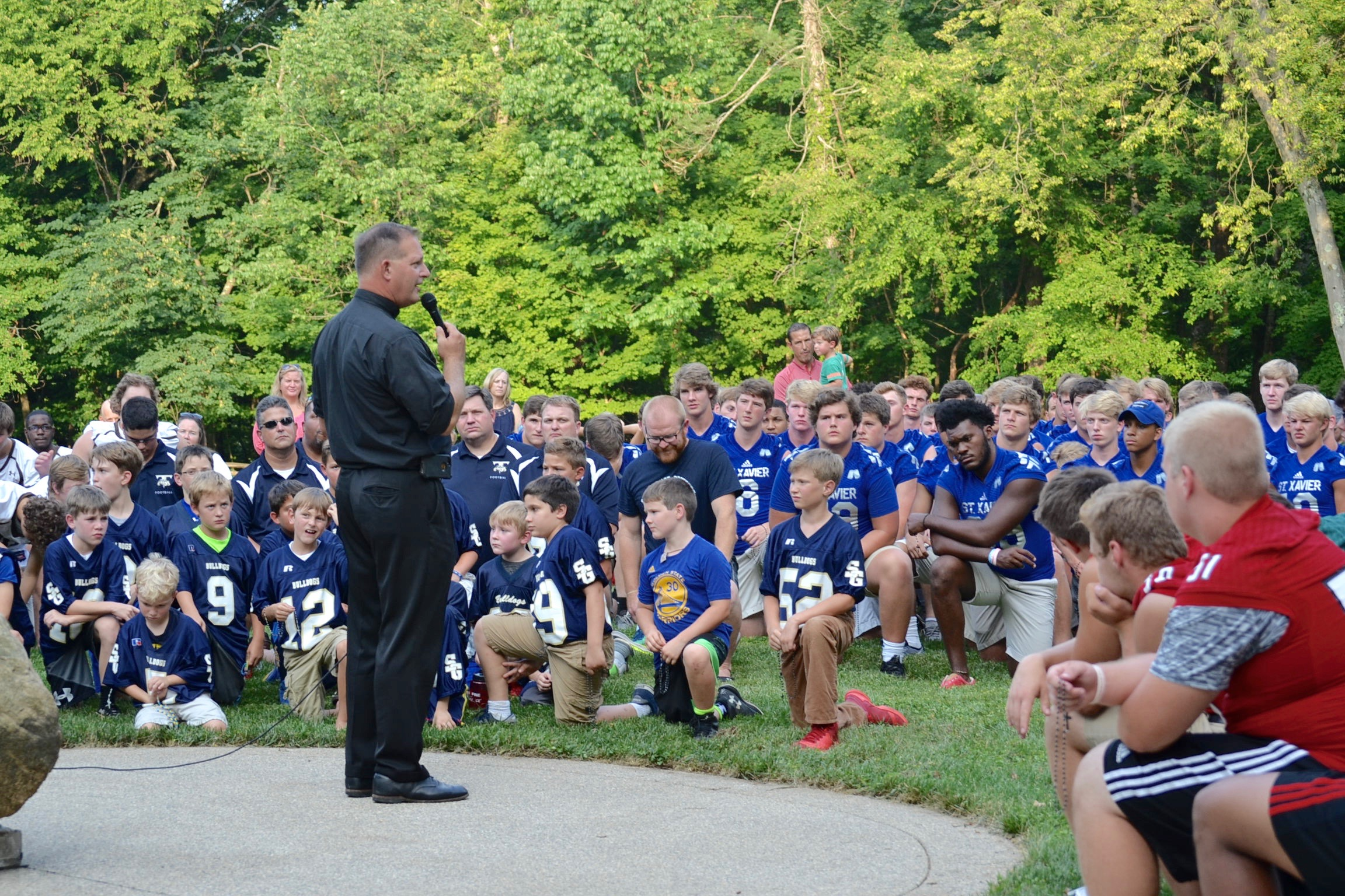 Father Brausch addresses the players. (CT Photo/Gail Finke)
