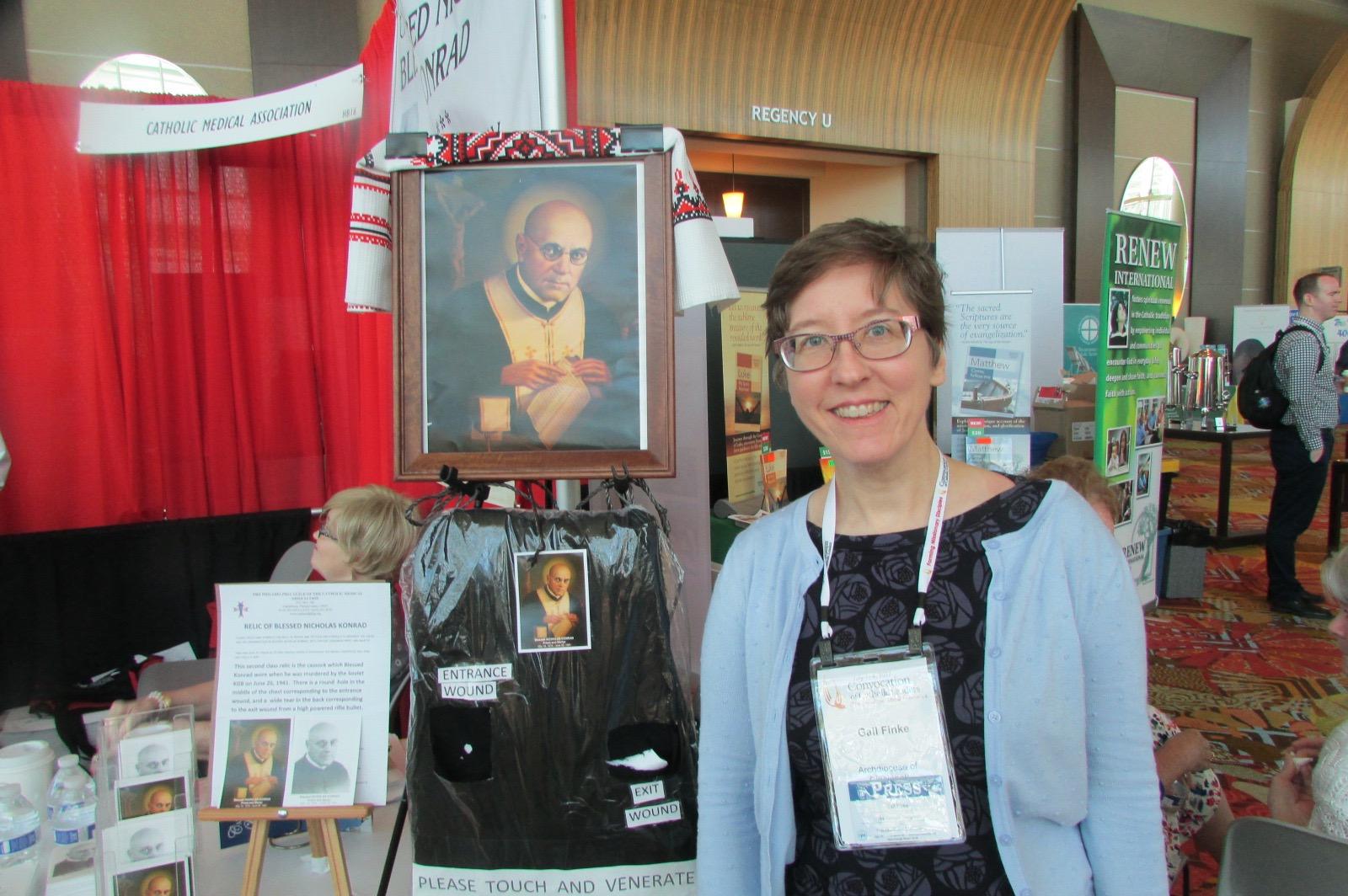 Writer/photographer Gail Finke with the portrait of Bl. Nicholas Konrad. (CT Photo)