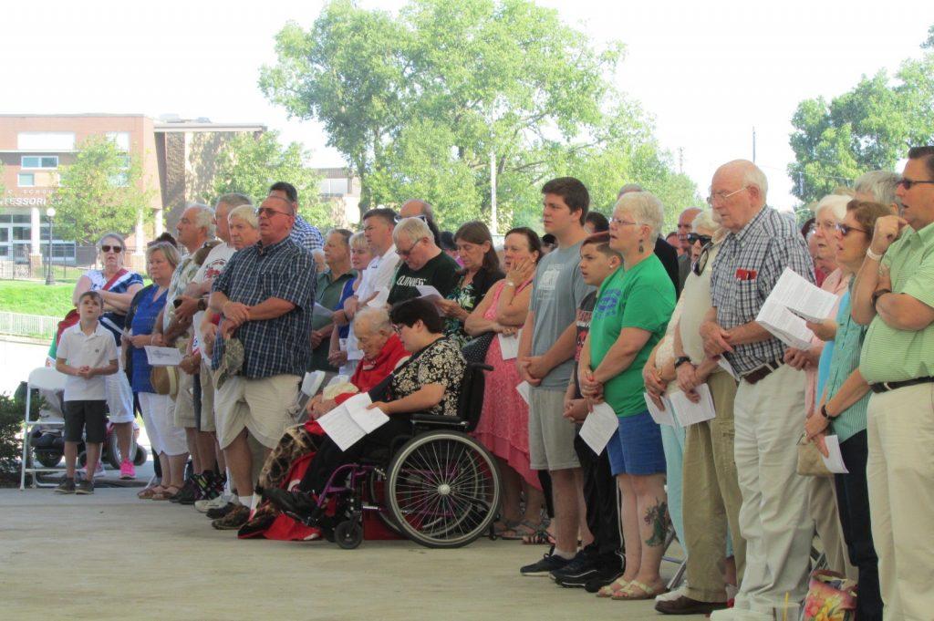 Hundreds of people pray at the Irish Mass at the Dayton Celtic Festival (CT Photo/Gail Finke)