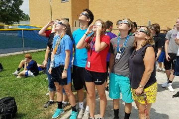 Carroll High School Students in Dayton looking at partial eclipse 2017 (Courtesy Photo)