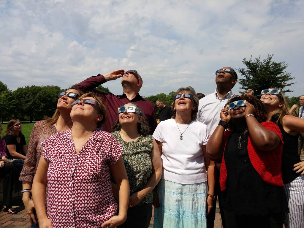 The partial eclipse of the sun is viewed at the University of Dayton)