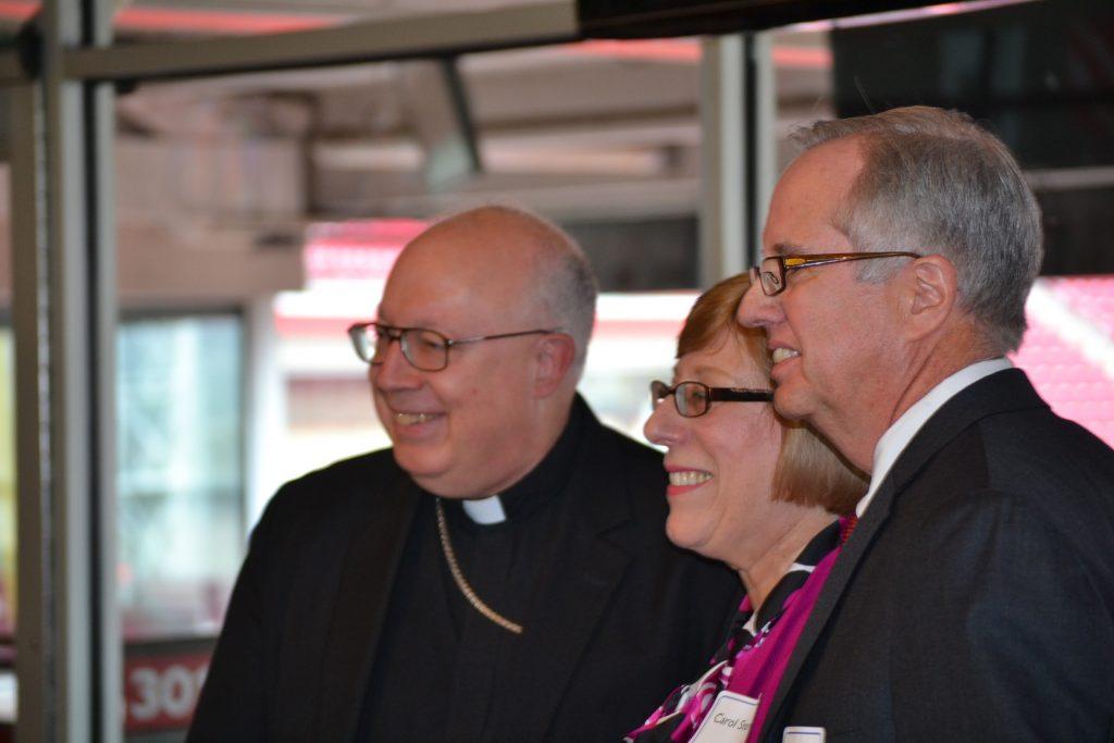 Bishop Binzer presents Carol & Richard Stevie with the Faith in Education Award. (CT Photo/Greg Hartman)