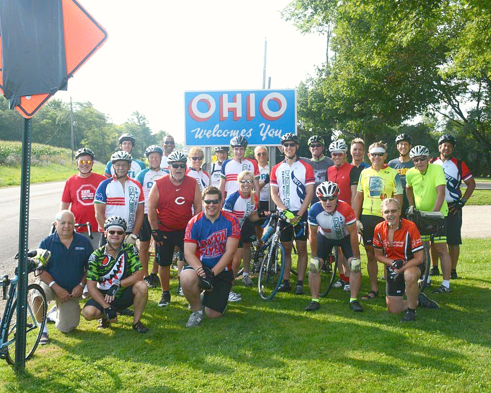 Still smiling, the group stops for a photo at the Ohio border. (Courtesy Photo)