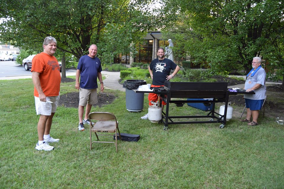 St. Ann Groesbeck parishioners man the grill for the parish cookout. (Courtesy Photo)