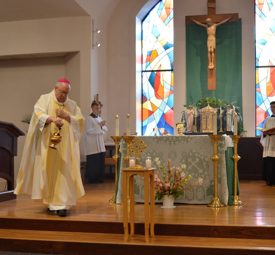 Bishop Joseph R. Binzer censes the altar and relic of St. Ann. (Courtesy Photo)