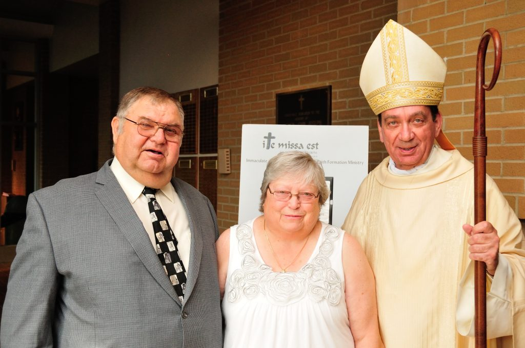 Michael and Lu Zecchini pose for a photo with Archbishop Schnurr after the Golden Jubilee Mass in Dayton. (CT Photo/Jeff Unroe)