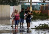 People walk in a flooded street Sept. 21 in Toa Baja, Puerto Rico, in the aftermath of Hurricane Maria. (CNS photo/Thais Llorca, EPA)
