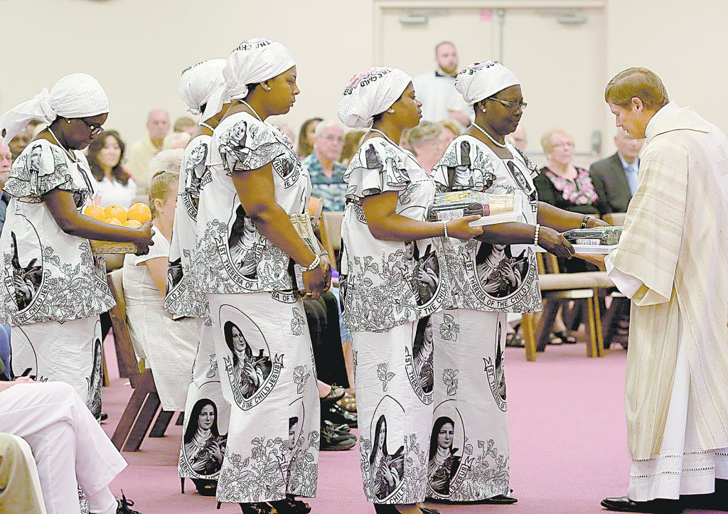 Ghanaian members of the congregation present the Gifts during the 50th Anniversary Mass of St. Matthias the Apostle Catholic Church in Cincinnati Sunday, Aug. 6, 2017. (CT Photo/E.L. Hubbard)