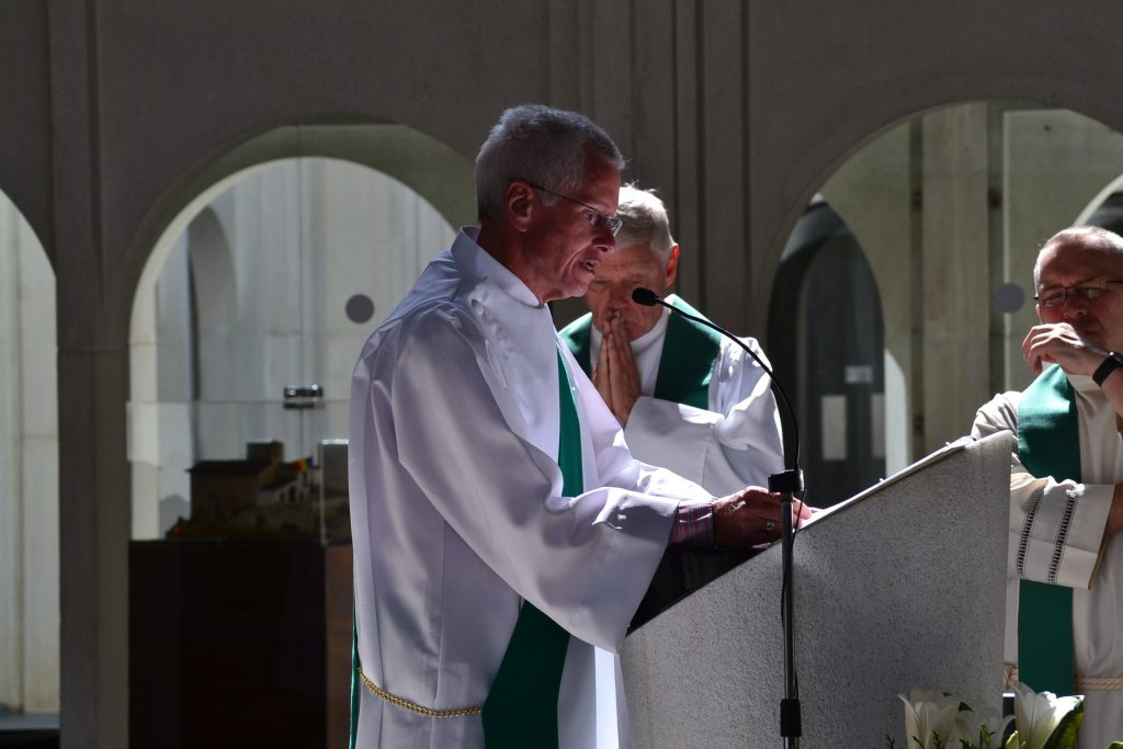 Deacon Tim reads the Gospel at Mass at Our Lady of Mertixell in Andorra (CT Photo/Greg Hartman)