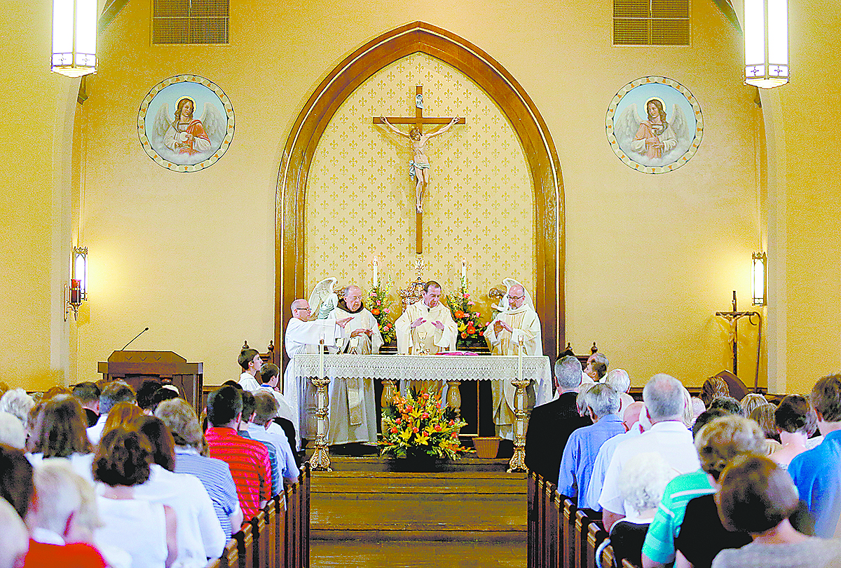 Archbishop Dennis Schnurr and the Concelebrants prepare the Gifts during the Feast of St. Bernard Mass and the closing of the One Hundred and Fiftieth Anniversary Year at St. Bernard of Clairvaux Catholic Church in Cincinnati Saturday, Aug. 19, 2017. (CT Photo/E.L. Hubbard)