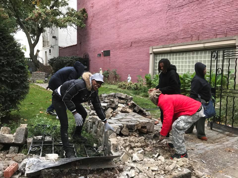 Homeless men and women passing the church on their way to the Mary Magdalene House, which offers free showers and other services, stopped to help Sister Marie-Cecilie clean up the heavy granite bricks strewn over the sidewalk and garden.  COURTESY PHOTO