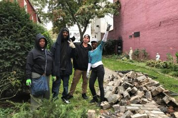 Several of the people who stopped to help posed for this group photo. About 10 people, all of them homeless, helped with the cleanup over the course of the morning, said Sister Marie-Cecile. COURTESY PHOTO