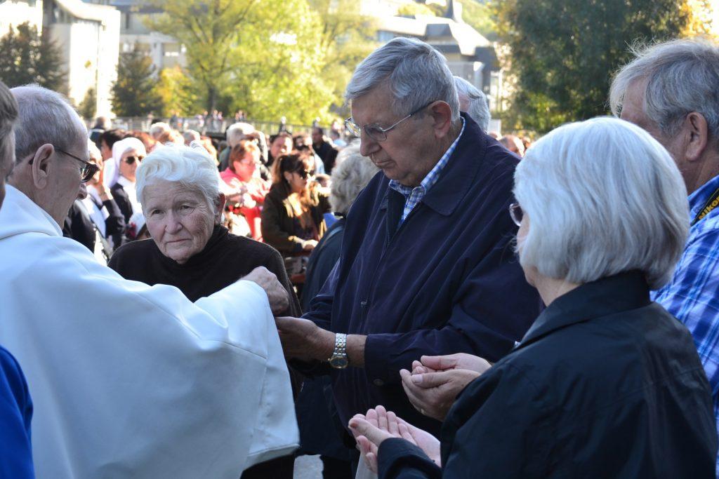 Receiving Communion during English Speaking Mass at Lourdes France, September 29, 2017 (CT Photo/Greg Hartman)