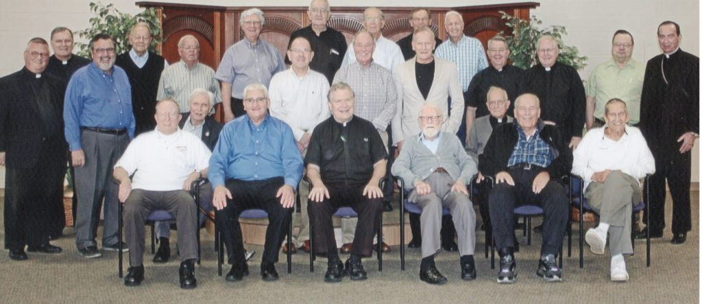 From left to right the Back Row: Frs. Jerome Bishop, Frank Voellmecke, Michael Flaherty, Terry Meehan, Pat Crone, Bob Obermeyer, Mike Pucke, Dave Robisch; Middle Row, Frs. Benedict O'Cinnsealaigh, Bob Schmitz, Bob Goebel, John Wall, Ray Kellerman, Tom Dennemann, Tom King, Mike Leshney, Dennis Dettenwanger, and Archbishop Dennis Schnurr; Front Row: Frs. Tom Fitzsimmons, Clarence Heis, Dale Petreka, Joe Beckman, Carl Wollering, nad Jack Wessling. (Courtesy Photo)