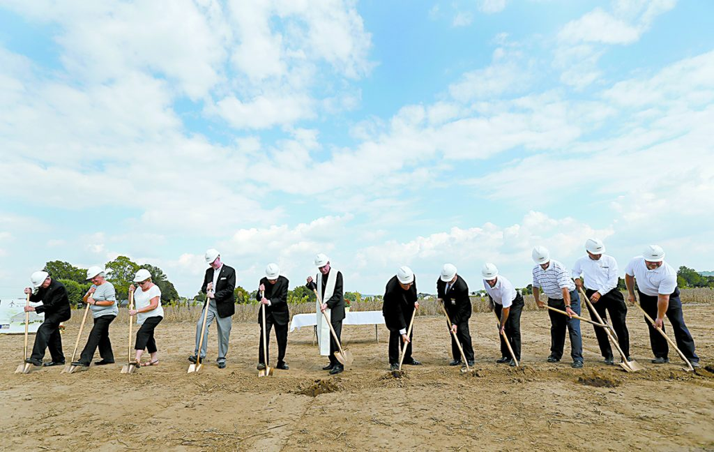 Archbishop Dennis Schnurr, center, with stole, and other church, community, and civic leaders break ground for the new St. John the Baptist Church in Harrison Sunday, Sept. 17, 2017. (CT Photo/E.L. Hubbard)